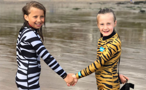 Children in Saltskin wetsuits