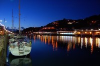 A boat in the harbour at night