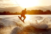 A wakeboarder catching air