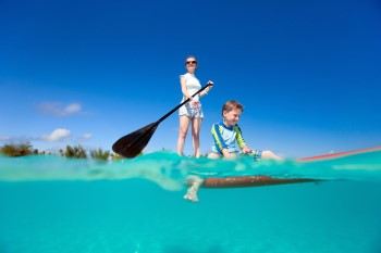 Girl and boy on a Stand Up Paddleboard