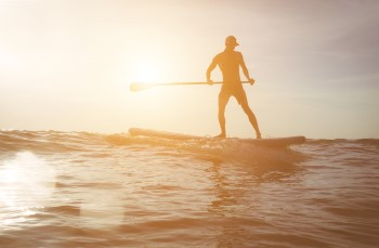 Paddleboarder in the sun